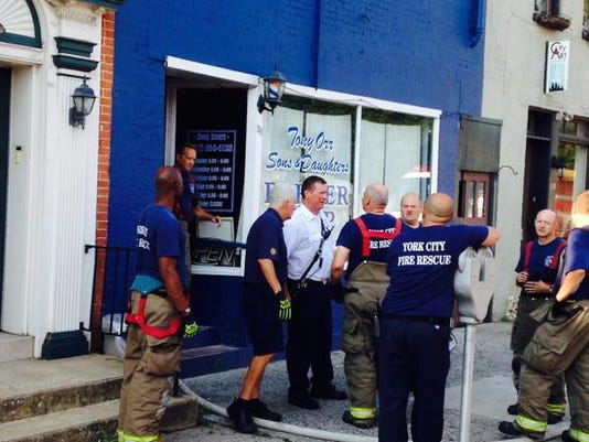 Firefighters are investigating a fire inside Tony Orr Sons and Daughters Barber Shop.