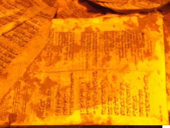 A torn up Quran covered in feces was found outside