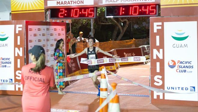 In this file photo, Sho Machimoto crosses the finish line of the 2016 Guam International Marathon.