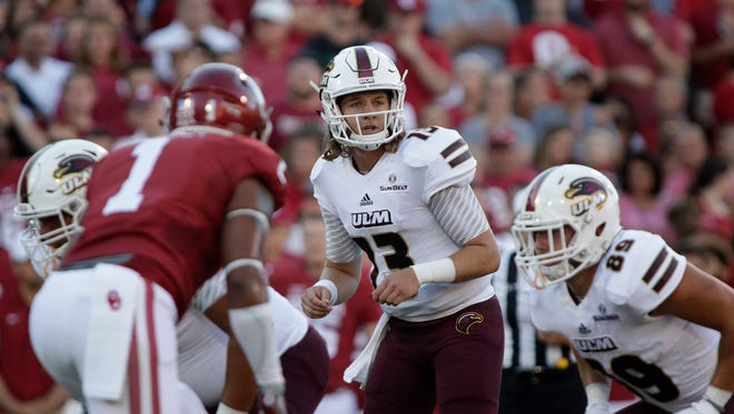 ULM quarterback Garrett Smith (13) established a new career-high by throwing a 73-yard touchdown pass to R.J. Turner in the Warhawks' 23-21  loss to Georgia Southern on September 17.