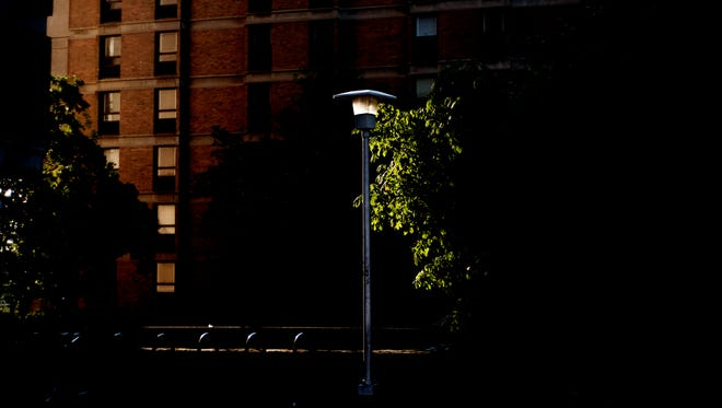 Evening sunlight hits a lamp post outside Reese Hall on the University of Tennessee campus in Knoxville on June 14. Three rapes have been reported on the UT Knoxville campus in September.
