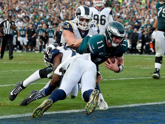 Philadelphia Eagles quarterback Carson Wentz gets tackled