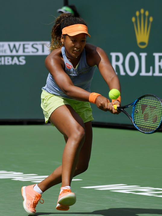 Naomi Osaka, of Japan, returns a shot to Daria Kasatkina, of Russia, in the women's final at the BNP Paribas Open tennis tournament, Sunday, March 18, 2018, in Indian Wells, Calif. (AP Photo/Mark J. Terrill)