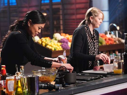 """Neenah native Emily Hallock, right, earned a white apron during the season premiere of """"MasterChef."""""""