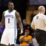 Charlotte Hornets guard Lance Stephenson (1) argues a call with referee Ron Garretson  during the first half of an NBA  game  Saturday, April 4, 2015. After one season in Charlotte, Stephenson split the 2015-16 season between the L.A. Clippers and Memphis Grizzlies.