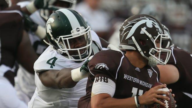 Michigan State's Malik McDowell pressures the Western Michigan Broncos' Zach Terrell on Sept. 4, 2015.