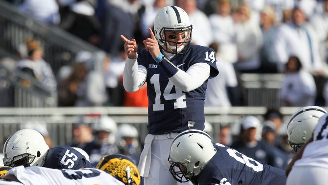 Penn State quarterback Christian Hackenberg signals during the first quarter against the Michigan Wolverines at Beaver Stadium.