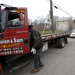 Detroit towing battle flares anew