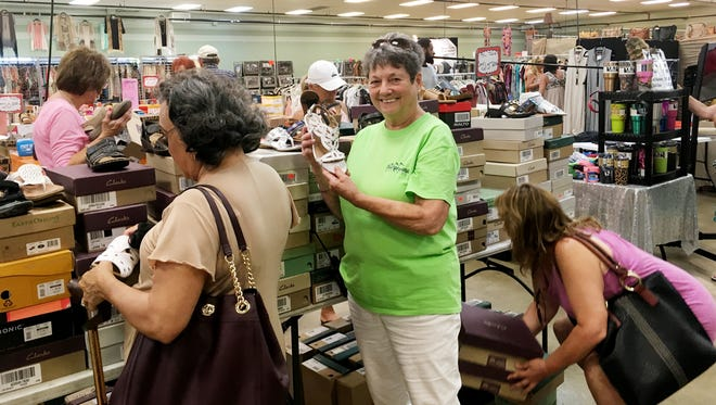 Nashville Flea Market Manager Mary Ann Smith, center, says shoes are a popular item at the monthly markets.