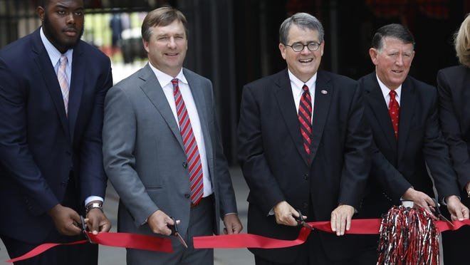 From left Georgia offensive lineman Andrew Thomas,  head coach Kirby Smart, University president Jere W. Morehead and athletic director Greg McGarity cut the ribbon during the dedication ceremony for the new West End Zone at Sanford Stadium in Athens, Ga., Friday, August 31, 2018.