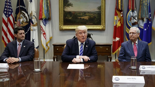 House Speaker Paul Ryan, R-Wis., left, Senate Majority Leader Mitch McConnell, R-Ky., right, and President Donald Trump meet at the White House on Sept. 5, 2017.