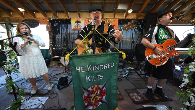 The Irish band Kindred Kilts, made up of Brenda Quesenberry (from left), Charlie Quesenberry and Larry Fitch, perform March 11, 2017, at the Summer Crush Vineyard and Winery in Fort Pierce.