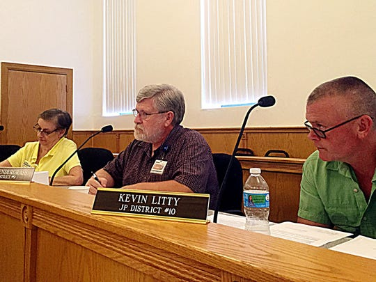 Justices Edna Fusco, at left, Neal Pendergrass and Kevin Litty listen to the reading of an appropriation measure.