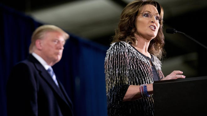 Former Alaska Gov. Sarah Palin, right, endorses Republican presidential candidate Donald Trump during a rally at the Iowa State University, Tuesday, Jan. 19, 2016, in Ames, Iowa.