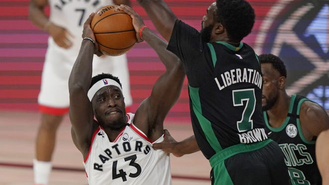 Toronto Raptors forward Pascal Siakam is defended by Boston's Jaylen Brown in the first half of Tuesday's conference semifinal playoff game in Lake Buena Vista, Fla.