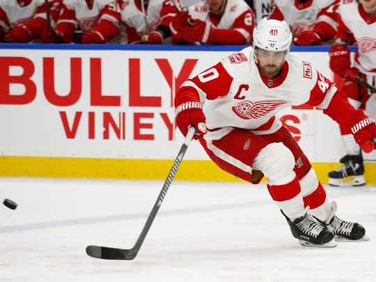 Red Wings forward Henrik Zetterberg tips the puck during a game against the Buffalo Sabres on  March 29, 2018.