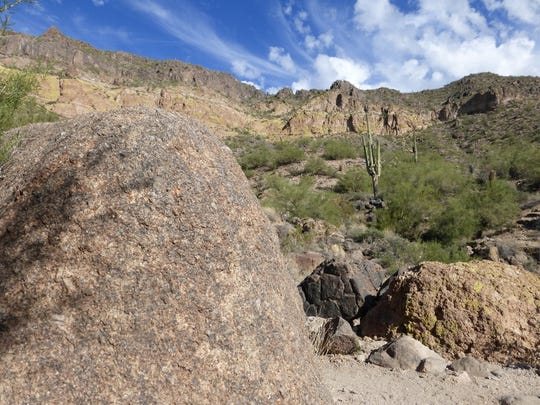 Wind Cave Trail leads to a cave where water seeps through the rock. Wind Cave Trail in the Usery Mountains.