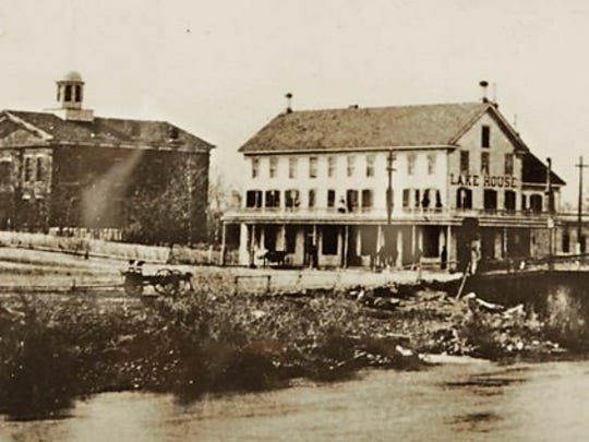 The Washoe County Courthouse (left), as it appeared around 1880, near the time of Rover's execution. The building on the right is the Lake House, which was replaced by the Riverside Hotel.