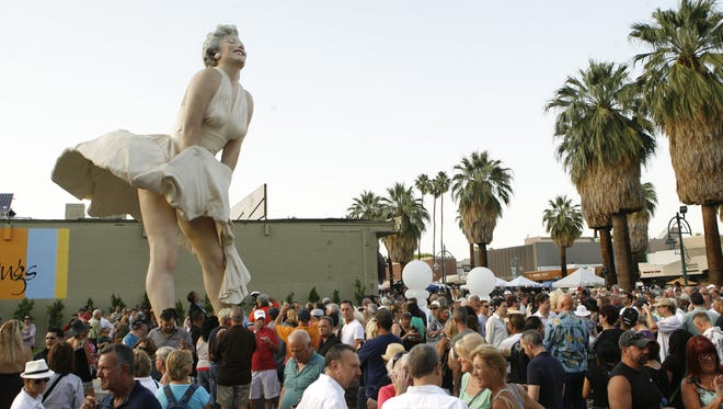 """Hundreds of people gather around """"Forever Marilyn,"""" the 26-foot-tall sculpture of the Hollywood icon Marilyn Monroe after the formal unveiling in downtown Palm Springs on Thursday May 24, 2012. The statue may return as early as late September to Palm Springs, a city to which the blonde bombshell had ties but in which she never lived."""