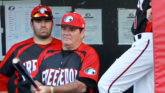 Pete Rose loosens up in the Florence Freedom dugout before stepping to the plate as an honorary batter at the game.