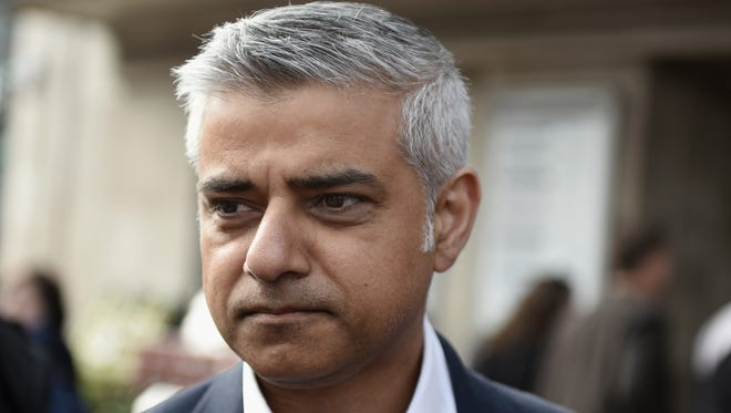 Sadiq Khan, the new Mayor of London speaks to the media as he campaigns outside Tooting Broadway Underground station with Labour Party candidate for the local by-election Rosena Allin-Khan on May 16, 2016 in London, England.