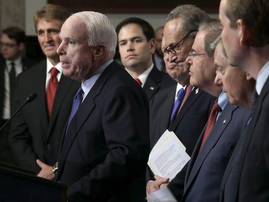 U.S. Sen. John McCain speaks in 2013 as the rest of