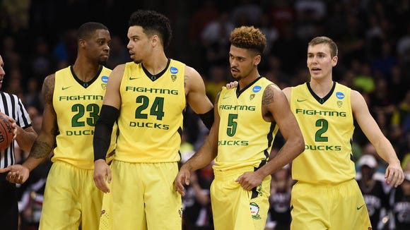 March 20, 2016; Spokane , WA, USA; Oregon Ducks forward Elgin Cook (23), forward Dillon Brooks (24), guard Tyler Dorsey (5) and guard Casey Benson (2) during a stoppage in play against St. Joseph's Hawks during the second half in the second round of the 2016 NCAA Tournament at Spokane Veterans Memorial Arena. Mandatory Credit: Kyle Terada-USA TODAY Sports