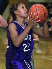 In this 2001 photo, Audrey Graham goes up for a shot
