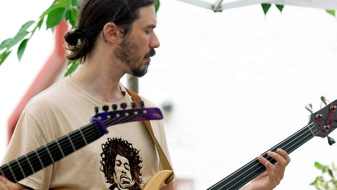 """""""Andrew Naylor plays fretless bass with \""""Grooovatine\"""" at Box Lunch Revue in Cherry Lane Courtyard Tuesday, July 21 2015. Box Lunch Revue live music program continues Tuesdays and Thursdays through August.  Bill Kalina - bkalina@yorkdispatch.com"""""""
