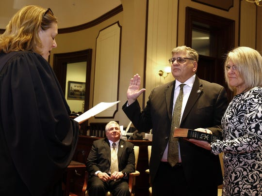 Ocean County Sheriff Michael Mastronardy is joined by his wife Diane as he is sworn in to another term by Ocean County Assignment Judge Marlene Lynch Ford at the Ocean County Courthouse in Toms River, NJ, Wednesday, January 4, 2017.