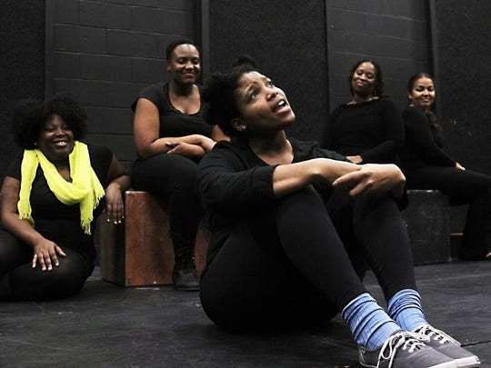 "Paige Dawkins, front, rehearses a scene from ""For Colored Girls Who Have Considered Suicide When the Rainbow Is Enuf"" at the Black Box Theater at Florida SouthWestern State College on Tuesday night."
