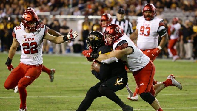Utah defensive end Hunter Dimick sacks Arizona State quarterback Manny Wilkins in the 2nd half during PAC-12 action on Thursday, Nov. 10, 2016 in Tempe, Ariz.