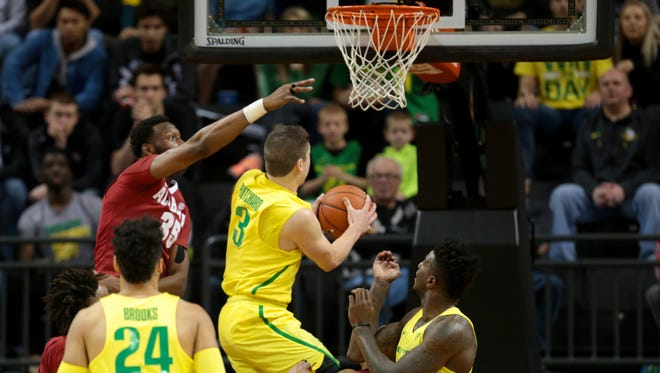 Dec 11, 2016; Eugene, OR, USA;  Oregon Ducks forward Dillon Brooks (24) and Oregon Ducks forward Jordan Bell (1) watch as Alabama Crimson Tide forward Donta Hall (35) defends while Oregon Ducks guard Payton Pritchard (3) shoot the ball in the first half at Matthew Knight Arena. Mandatory Credit: Scott Olmos-USA TODAY Sports