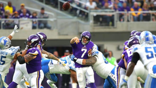 Vikings quarterback Case Keenum is hit by Haloti Ngata while throwing in the second half of the Lions' 14-7 victory on Oct. 1 in Minneapolis.