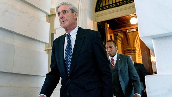 The Justice Department strongly defended special counsel Robert Mueller's probe on Friday.