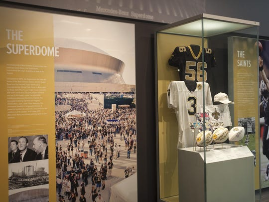 This is a second floor display of the Louisiana Sports Hall of Fame museum featuring the New Orleans Saints and the Superdome.