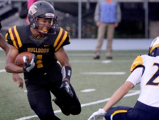 West Allis Central's Xavier Mullins ran for three touchdowns,