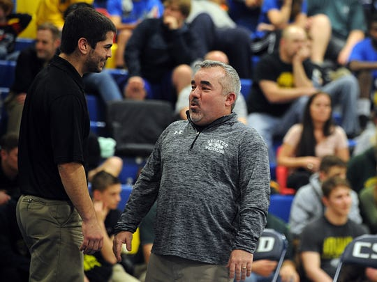 Stephen Decatur coach Todd Martinek reacts after seeing Jacob Caple's pin on Saturday, Feb. 18, 2017 at the Bayside wrestling championships.