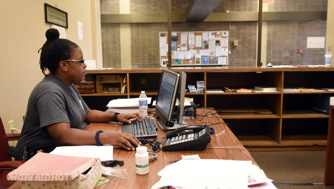 Veterans Court Officer Kamekia Adams works in the new offices for the county's drug court and veterans' court employees at the former Forrest County Jail in downtown Hattiesburg.