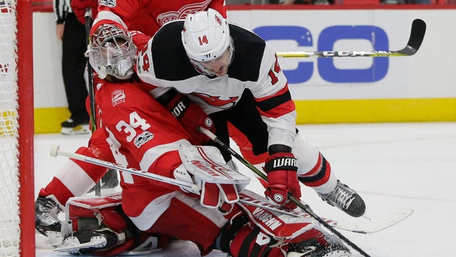 New Jersey Devils center Adam Henrique collides with Detroit Red Wings goalie Petr Mrazek during the third period. Mrazek was removed from the game.