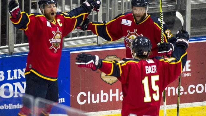 Peoria Riverman Alec Hagaman, left, celebrates his goal 14 seconds into the first period of the Rivermen 3-2 win over Pensacola Sunday, January 19, 2020 at Peoria Civic Center.