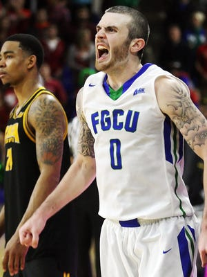 KINFAY MOROTI/THE NEWS-PRESS ... FGCU's Brett Comer celebrates beating Kennesaw State on Thursday (2/18/15) at Alico Arena in Fort Myers. FGCU beat Kennesaw State 54-53.