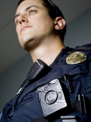 Senior Officer Chris Sweeney displays a Axon Body Cam, a device that records video and is issued to every officer at the Burlington Police Department in 2014