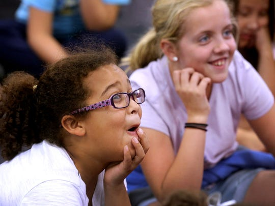 Cason Lane Academy students Olivia Whitworth and Katie Burns react to a story read by Tennessee first lady Crissy Haslam on Monday, Sept. 12, 2016.