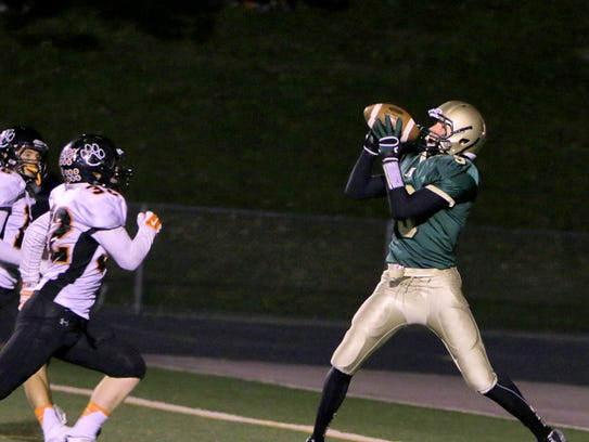 Brighton's Tyler Trisch (32) looks on as Howell's Michael