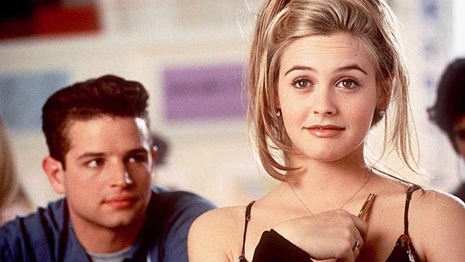 "Cher (Alicia Silverstone)  and Christian (Justin Walker) enjoy the Beverly Hills lifestyle in 1995's ""Clueless."""