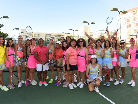 Players and teams representing The Diva League, an over-30 women's tennis league, line up for a group shot at The Hilton Guam Resort and Spa in Tumon on Sept. 27.