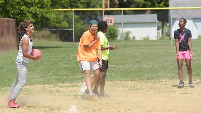 Giante Moore, 14, Owen Keister, 14, Neziyah McElvy, 14, and Taylor Pullen, 12, participate in the Tigerland and Trails Street Team  kickball tournament Saturday in Beaver Falls. Five teams participated in the event that was held on Saturday and Sunday.