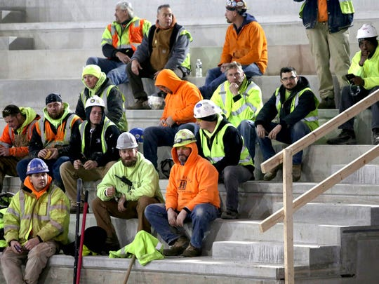 Construction workers listen to the press conference at Little Caesars Arena in Detroit in January 2017 announcing Kid Rock as the opening act of the new arena in September.