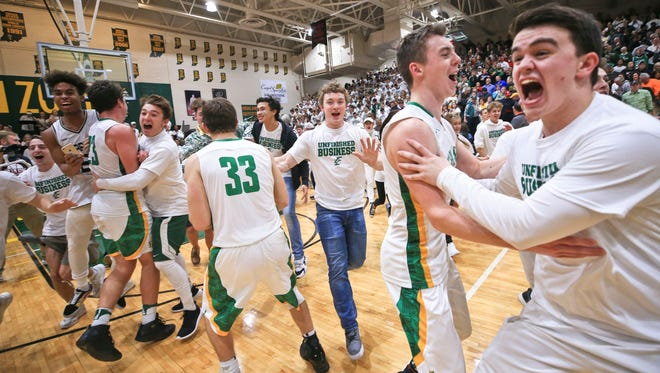 Floyd Central students and the basketball team jammed the court to celebrate after the Highlanders' 49-47 win over New Albany in overtime Friday evening. Senior Luke Gohmann led the Highlanders with 17 points. It was the Highlanders' first win over New Albany in boys basketball in 15 years.